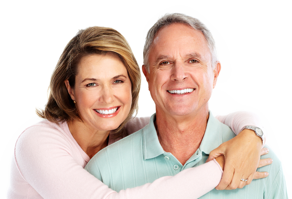 A middle aged woman with her hands around her husband
