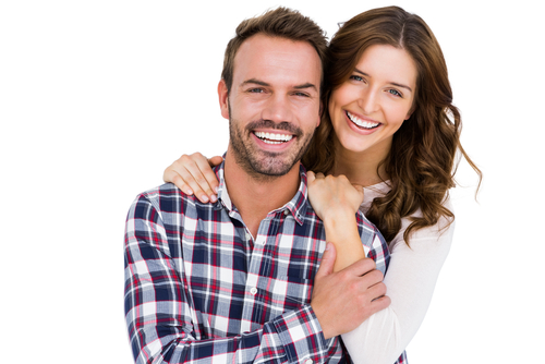 A woman with her arms around a man and smiling